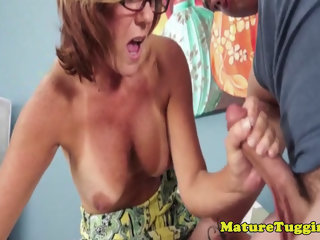Bigtitted spex milf jerking on cock