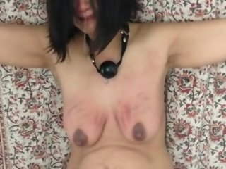 Floozy Endures a masculine Tit Beating