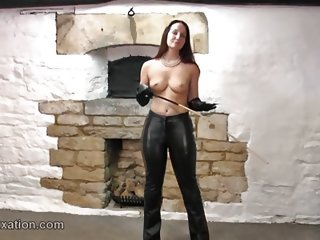 Hot dom babe rubs tits in leather and topless with whip